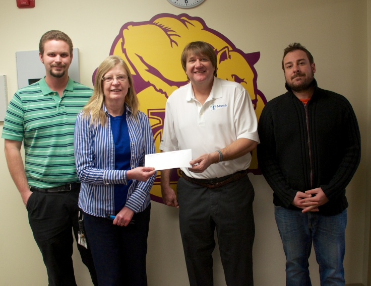Mark Owen (center) presented a check to the Lapeer Community High School on Tuesday in the amount of $1,800. The funds will be used for EBLI training for members of the LCHS staff. From left to right: Doug Grover, Cindy Tanke, Mark Owen and Bill O'Bryan.