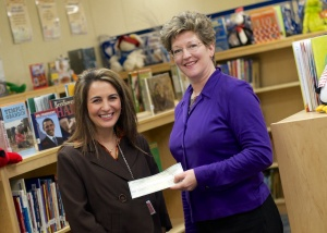 Mayfield Elementary Principal Traci Chouinard (left) poses with Ashley White, Executive Director of the Lapeer County Community Foundation.