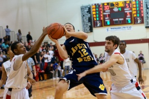 Lapeer West's Cullen Turczyn drives for two of his game-high 27 points against Grand Blanc.