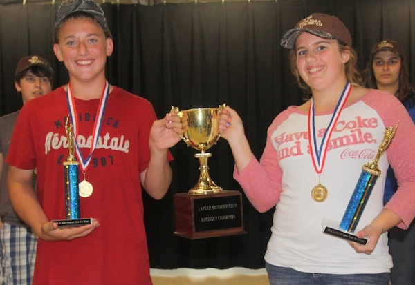Eighth grade archers Curtis Taylor and Alexis Felton will have their named etched into this trophy after the earned top honors at their school's first archery tournament on Thursday.