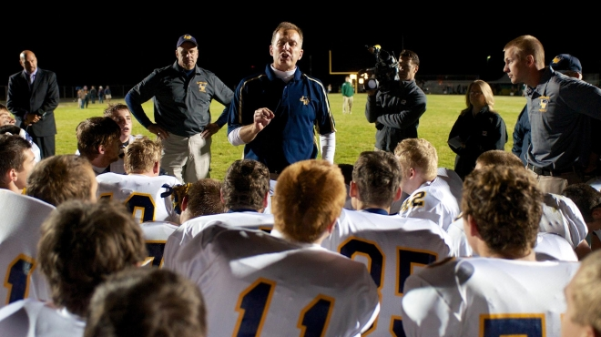 Lapeer West head coach Mike Smith speaks to his team after the win over Lapeer East on Friday night.  (LCS photo)
