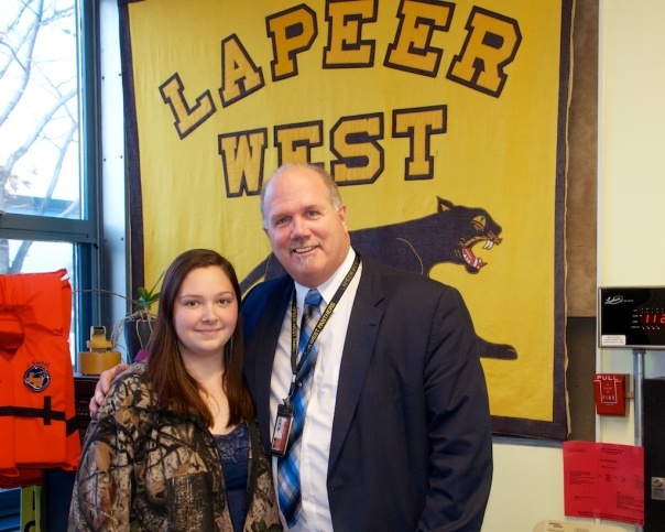 Christen Thompson poses for a picture with Lapeer West Principal Tim Zeeman.