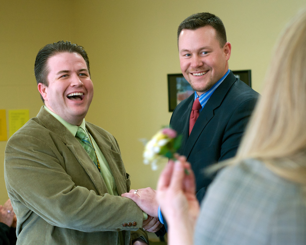 Zemmer Middle School Principal Matt Olson (left) was surprised at the school on Wednesday morning with a Distinguished Service Award from LCS Superintendent Matt Wandrie.