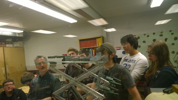 Tony Diodato of Cypress Computer Systems, center, reviews robot-building strategies with a small group of students from his new Strike Zone robotics team, along with students from Lapeer robotics Team 1684, the Chimeras.
