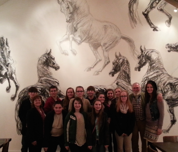 Students pose for a photo with noted French artist Jean-Louis Savaut at the White Horse in Metamora. From the left to right  front row – Madame Clem, Kole Klebba, Madeline Melo Lily, Bourret, Hanna Schlaud,  back row – Brent Walker, Brendan Hall, Lyndsay Stickley, Merideth DeWitte, Joe Shultz, Katie Gariglio, Brooklyn George, Brianna George, Jean-Louis Sauvat, Madame Newton.