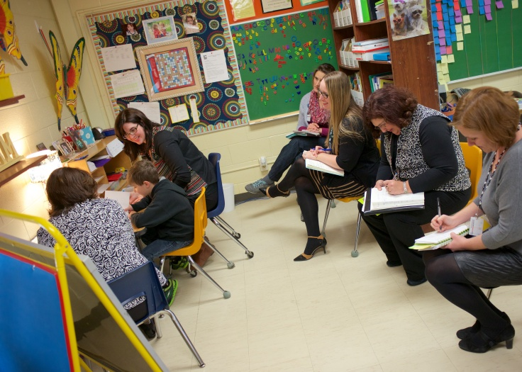 A group of four participate in a Reading Recovery cluster visit in the Title I room at Lynch Elementary. Top to bottom: Kasie Allen, Cortney Brendel, Cheryl Smith and Karen Allmen.