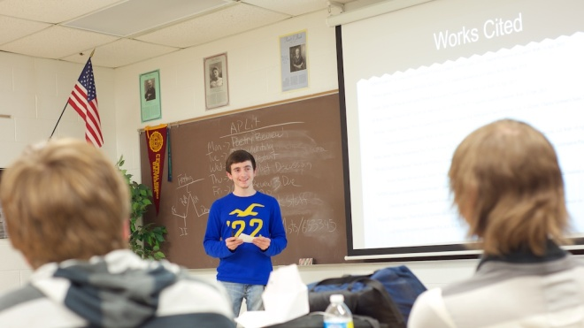 LHS junior Thomas McCaffrey presented his findings on